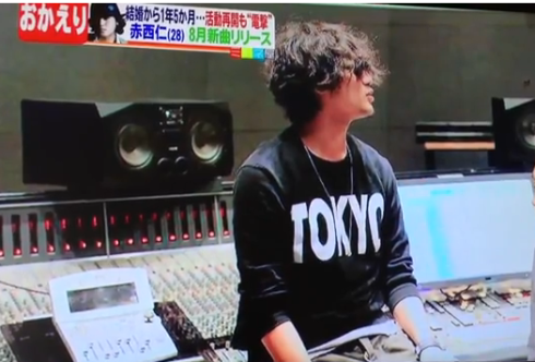 This glaring shirt follows him all the way to recording studio.